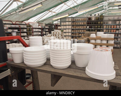 A rich supply of flowerpots for garden balcony and living room use in a gardening centre in Oslo Norway - Stock Image