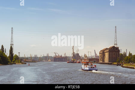 Boat trip on the Martwa Wisla river through the Gdansk shipyard, Poland, Europe - Stock Image