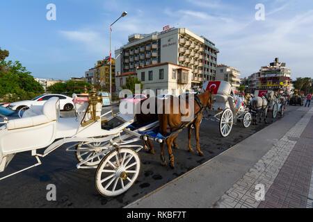 KUSADASI, TURKEY - MAY 23, 2015: Horse carriage on the street of Kusadasi, Turkey. - Stock Image