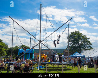 Children on a Bungee Trampolin at a Family Fun Day in North Yorkshire - Stock Image