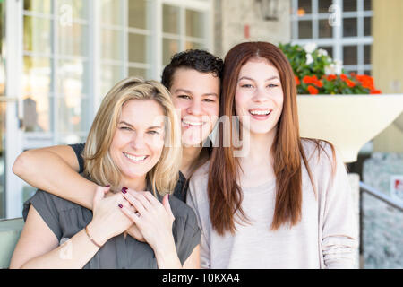 Latin mother and her son and daughter. - Stock Image