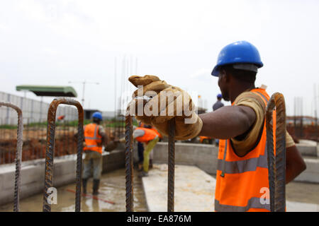 Construction Workers taking a break at the building site - Stock Image