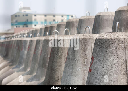 barrier concrete cement block tetrapod industrial depth of field - Stock Image