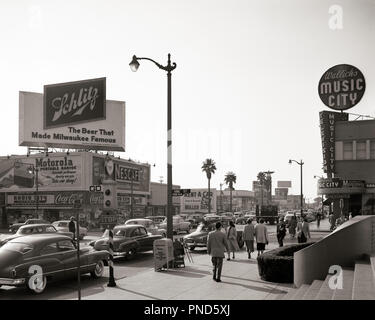 1950s BUSY STREET SCENE SUNSET BOULEVARD AND VINE STREET HOLLYWOOD CALIFORNIA LOOKING WEST FROM NBC BUILDING  - q53016 HAR001 HARS LOS ANGELES OLD FASHIONED - Stock Image