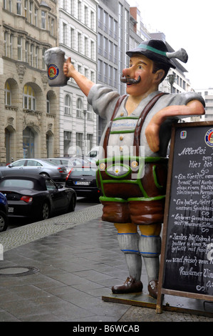 bierkeller advertisement figure model mannequin traditional sign alcohol berlin mitte germany deutschland street - Stock Image