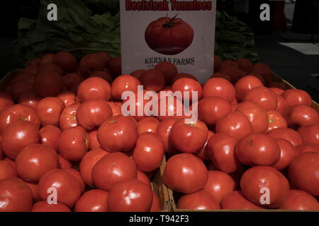Beefsteak tomatoes for sale in the Union Square Farmers Market. Union Square is a historic Manhattan park that opened in 1839. - Stock Image
