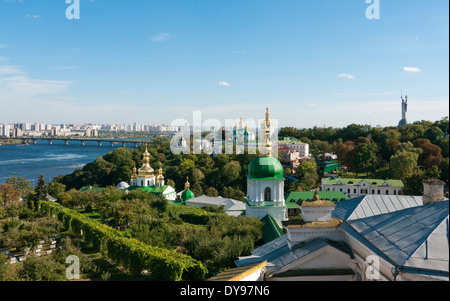Kiev skyline viewed from Pechersk across the Dnieper River with the Motherland statue on the right Ukraine - Stock Image