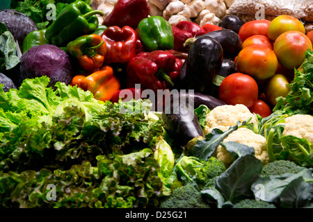 Fruits and vegetables at a stand, on a market. - Stock Image