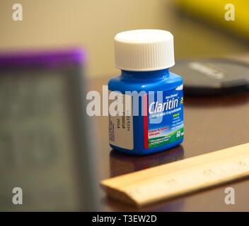 Claritin Tablets on Desk - Stock Image