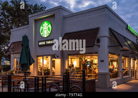 Early morning activity at Starbucks Coffee in Jacksonville Beach, Florida. (USA) - Stock Image