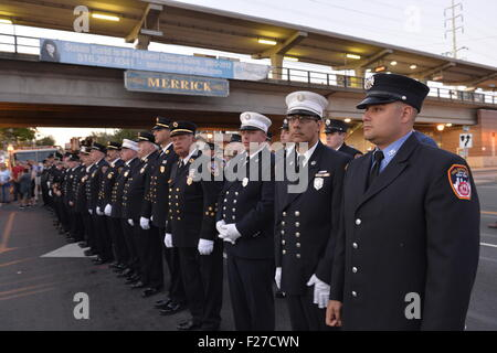 Merrick, New York, USA. 11th September 2015. Firefighters from Merrick and New York City stand in line during Merrick - Stock Image