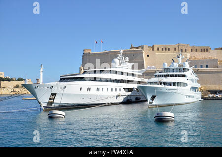 Luxury Yachts in the Grand Harbour at Birgu in the Maltese Three Cities. - Stock Image