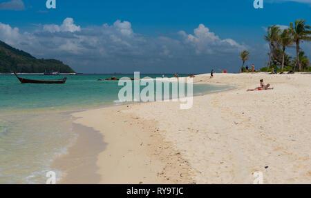 People sunbathing on Koh Lipe beach, Thailand - Stock Image