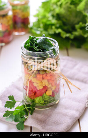 Homemade healthy salads with vegetables in jar - Stock Image