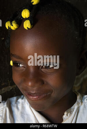Portrait of a playful girl with Angolan traditional hairstyle, Namibe Province, Caraculo, Angola - Stock Image