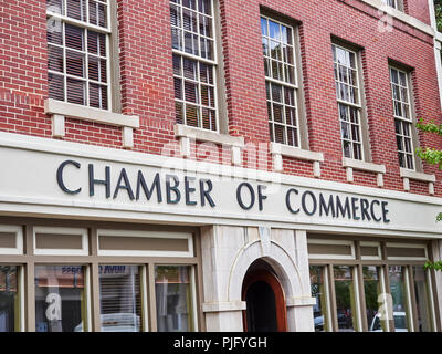 Chamber of Commerce sign on front exterior of the business promotion organization building in Montgomery Alabama, USA. - Stock Image
