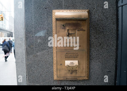 The Art Deco building that once housed the East River Savings Bank in Lower Manhattan was turned into a store but the bank's night depository remains. - Stock Image