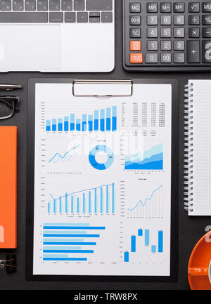 Office workplace table with report page, coffee cup, supplies and computer Flat lay. Top view with space for your goals - Stock Image