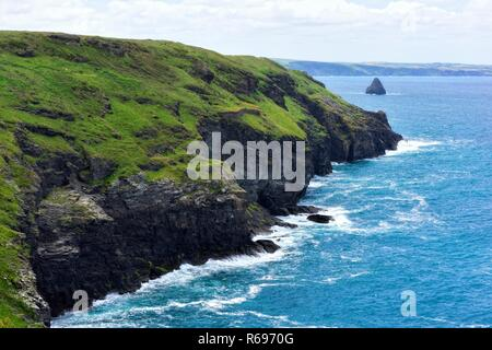 Tintagel coastline with Gull rock in the background,Cornwall,England,UK - Stock Image