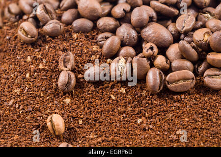 Picture of a group of coffee beans with coffee powder - Stock Image