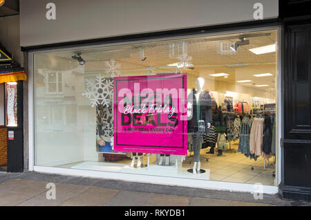 Black Friday signs on Bonmarche shop window. - Stock Image