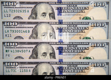 Close up of new hundred dollar bill with portrait of Franklin - Stock Image