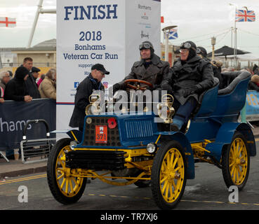 Mr Andreas Arrgard driving his 1904 Pope-Toledo, across the finishing line of the 2018 London to Brighton Veteran Car Run - Stock Image