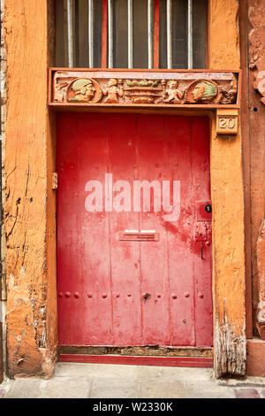 Wooden doorway detain in Rennes the capital of Brittany, France - Stock Image