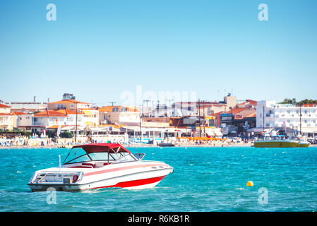 Motor boat near sea shore of mediterranean resort. Summer vacation on the sea. Boat for rent. - Stock Image