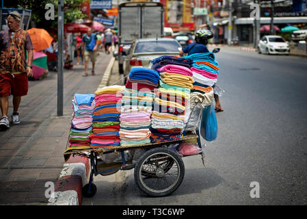 Towels for sale on a street hand cart. Thailand Southeast Asia - Stock Image