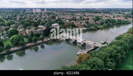 Aerial view of a bridge and a lock on the river Thames at Richmond, West London - Stock Image