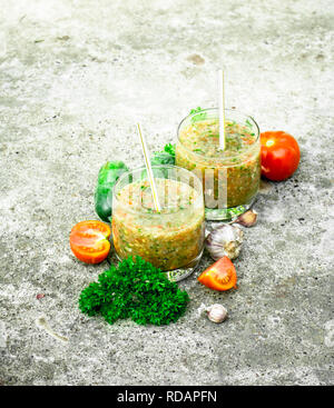 Vegetable smoothie in glasses. On rustic background. - Stock Image
