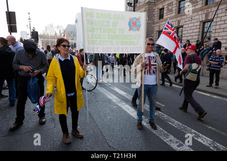Protestors  with banners, demonstrate on parliament green against the delay's to Brexit, on the day the UK should have left the EU - Stock Image