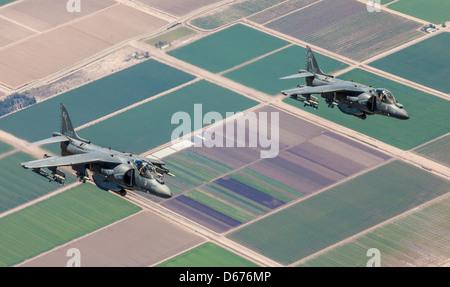 Maj. James Vallario, an AV-8B Harrier pilot with Marine Aircraft Group 13, right, and Maj. John Grunke, an AV-8B - Stock Image