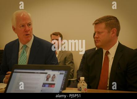 Under Secretary of the Army Ryan D. McCarthy and Texas Sen. John Cornyn discuss newly activated Army Futures Command during a roundtable discussion held at the command's headquarters in Austin, Texas, Aug. 24, 2018. Austin was selected as the home of the command because it provides to best opportunity to collaborate with private sector, leaders of industry and the University of Texas. (U.S. Army photo by Sgt. Michael L. K. West/Released) - Stock Image