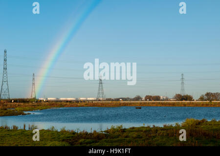 A view of wetland habitat under a rainbow at RSPB Saltholme, Middlesbrough, Teesside. October. - Stock Image