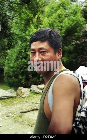 Portrait of Guide Chayngba Tamang on Annapurna circuit Himalayas Nepal - Stock Image