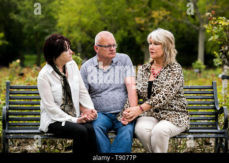 (left to right) Kate Walmsley, Ron Graham, and Margaret McGuckin from the SAVIA lobby group, have called on the Northern Ireland Secretary of State Karen Bradley to resign in her failure to process payments to survivors and victims of institutional abuse in Belfast, Ireland. - Stock Image