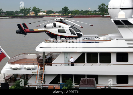 Helicopter sitting atop a luxury yacht, New Orleans, LA, USA - Stock Image