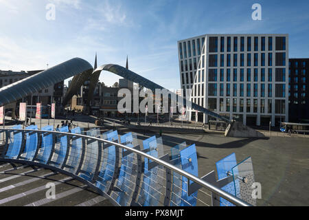 The pedestrian Glass Bridge and Whittle Arch sculpture in Coventry city centre UK - Stock Image
