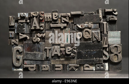 Old metal blank printing press typeset all stacked up - Stock Image
