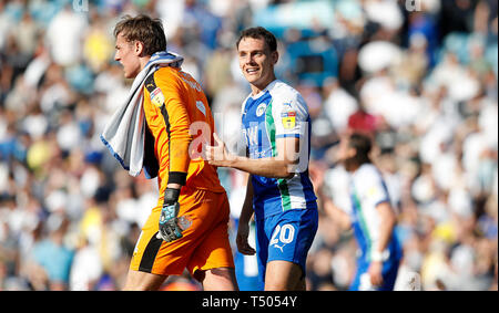 Wigan Athletic goalkeeper Christian Walton and Kal Naismith celebrate after their teams 2-1 win against Leeds United, during the Sky Bet Championship match at Elland Road, Leeds. - Stock Image