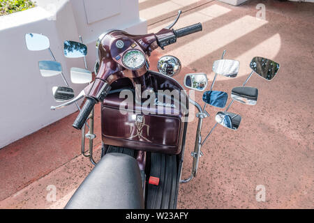 A Vespa motorscooter with 12 mirrors. - Stock Image