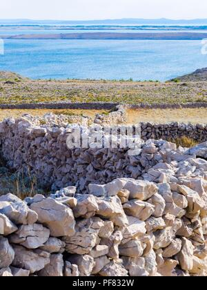 Stome walls near Smokvica on Pag island in Croatia - Stock Image