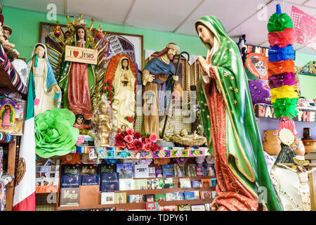 Florida Immokalee Mimi's Pinatas & Party Rentals inside gifts religious figurines statuettes virgin display sale - Stock Image