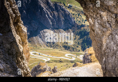 a rock windows from the Sass Pordoi plateau in Dolomites, Trentino Alto Adige, northern Italy, Europe. View of the pass Pordoi with serpentines leadin - Stock Image