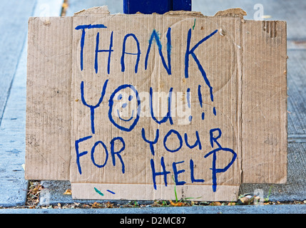 homeless person's sign - Stock Image