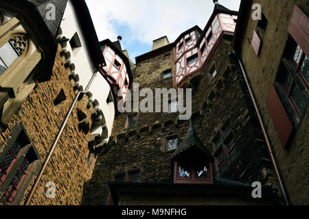 Facades of the fortification of Eltz Castle (Burg Eltz) as seen from the courtyard. - Stock Image