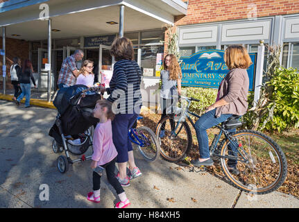 Merrick, New York, USA. Nov. 08, 2016. On Election Day, parents, accompanied by their children, are at Polling Place - Stock Image