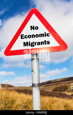No economic migrants concept sign UK migration problem with migrants entering UK to use NHS services for free - Stock Image